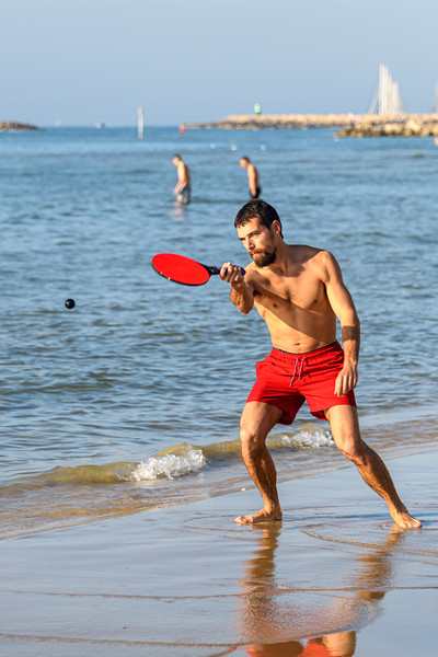 "Matkot (""racquets"") is a popular paddle ball game in Israel similar to beach tennis, often referred to by Israelis as their national beach sport."