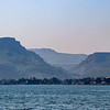 """Mount Arbel (left of valley) as seen from the Sea of Galilee. In 38 BCE, we are told by Josephus, partisans of Antigonus fighting against Herod who was conquering the land with Roman support, were either killed in their cave hideouts or committed suicide.<br /> <br /> It is also Josephus who, writing about himself in the third person, tells us how he fortified the caves and used them as storage base at the beginning of the First Jewish–Roman War in the year 66 CE, when he was in charge of the defense of Galilee: """"Moreover, he [Josephus] built walls about the caves near the lake of Gennesaret, which places lay in the lower Galilee"""". ~Wikipedia"""