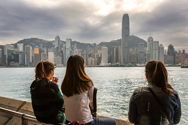 Enjoying the view on the promenade in Kowloon of the Hong Kong skyline