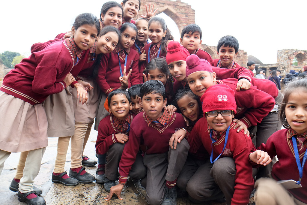 The youth of India excitingly posing for a shot. These kids are just too darn cute!!!