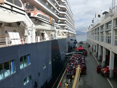 Zuiderdam at Canada Place, Vancouver, being loaded with luggage