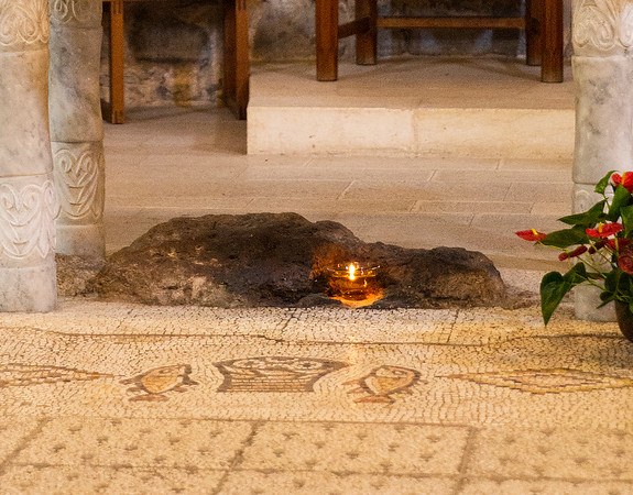 The mosaic of the fish and loaves is laid next to a large rock, which has caused some New Testament scholars to speculate that the builders of the original church believed that Jesus stood on this rock when he blessed the fish and loaves just before the feeding of the crowd who had come to hear him.