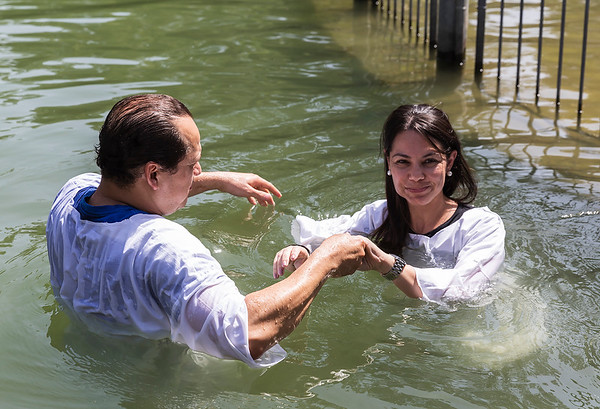 Lady prepares for a baptism from a pastor