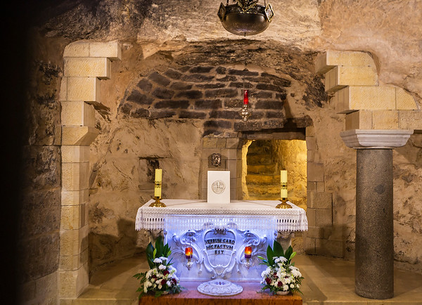 "This beautiful 18Th century altar dedicated to the Annunciation. On the right of the altar - an ancient  column, probably placed there in the fourth century to mark the place where the angel appeared. Behind it are stairs that lead up to a small cave (called ""Mary's kitchen"") and an exit to the yard.  On the Altar - the words "" Verbum Caro Hic Factum Est"" (""Here the word was made flesh""). This text is from John 1 14: ""The Word became flesh and made his dwelling among us. We have seen his glory, the glory of the One and Only, who came from the Father, full of grace and truth""."