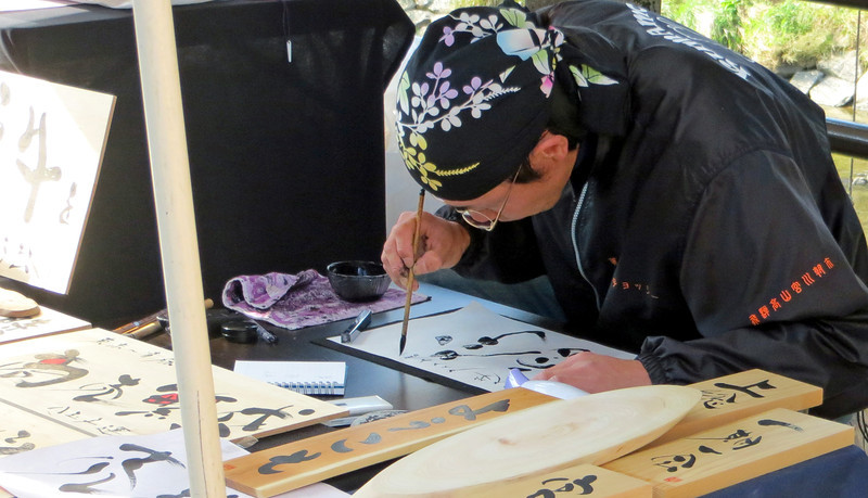 Takayama - Calligrapher working  at Miyagawa Morning Market