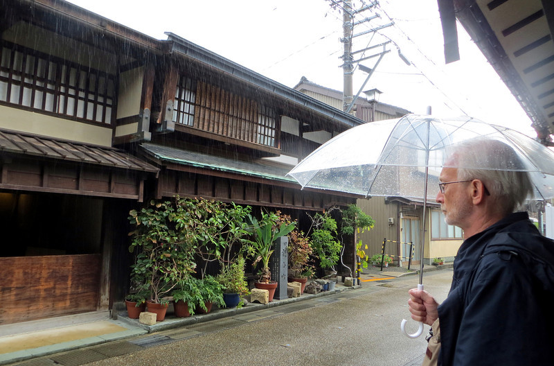 Kanazawa - Ochaya Shima. Street lined with houses with big red lattice doors, reminding us of feudal days.