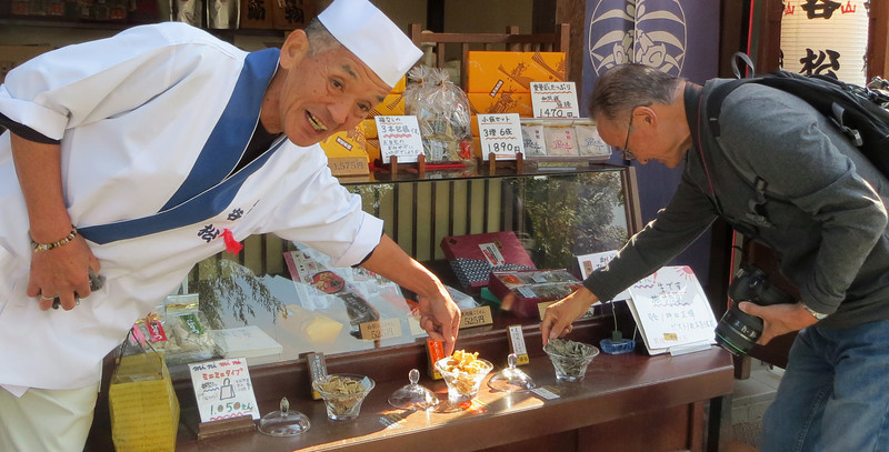 Takayama - Trying some free samples at the Miyagawa Market.