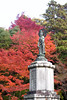 Japanese autumn trees and statue