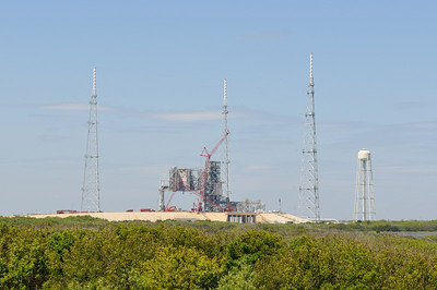 The old Challenger launch pad, being taken apart now. There are three large lightning rods around the old launch pad.