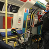 Dude on the tube with a bike.