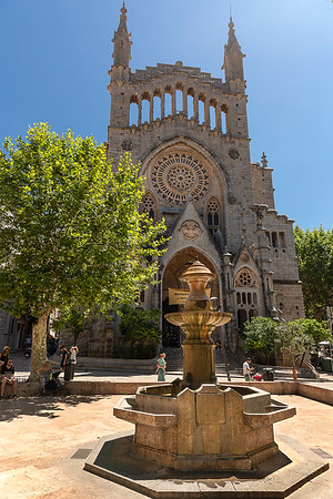 The church of Sant Bartomeu (Saint Bartholomew) in the town center with fountain