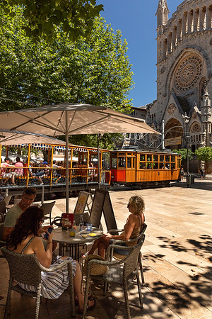 Many restaurants circle the square with the rail tram passing through.  The tram connects both Soller and Port Soller