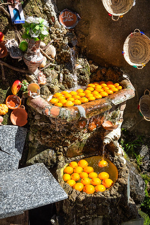 Oranges stay fresh and cool from natural water coming from the nearby river
