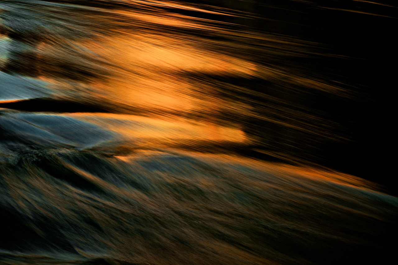 Canyon wall reflections in a wave at twilight