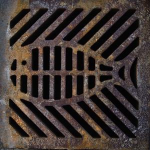 A sewer grate outside our house