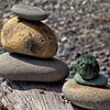 Balanced rocks on log