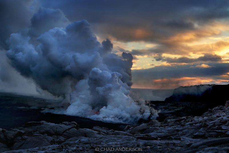 Big Island sunset with lava flow meeting the ocean in the foreground