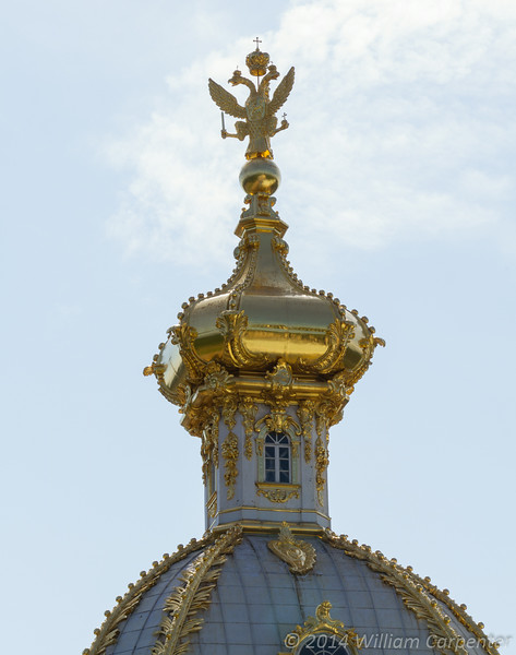 The gilded onion dome adornment over the Eagle House, the guest house at Peterhof. The eagle on the roof is unusual in that it has three heads. This is so that, no matter what angle it is viewed from, it will always appear to be the two-headed eagle that symbolizes Russia.