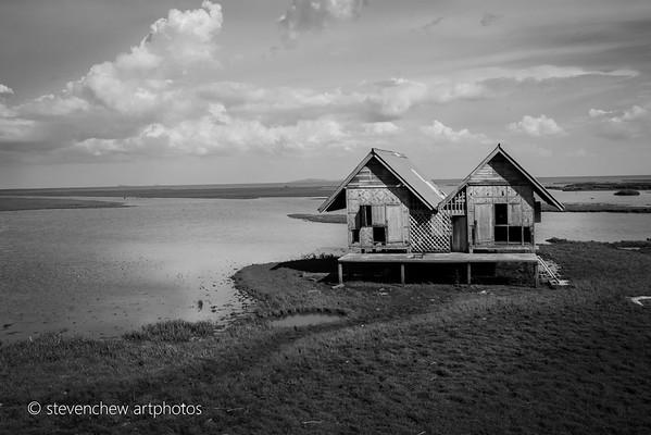 Huts in marshland