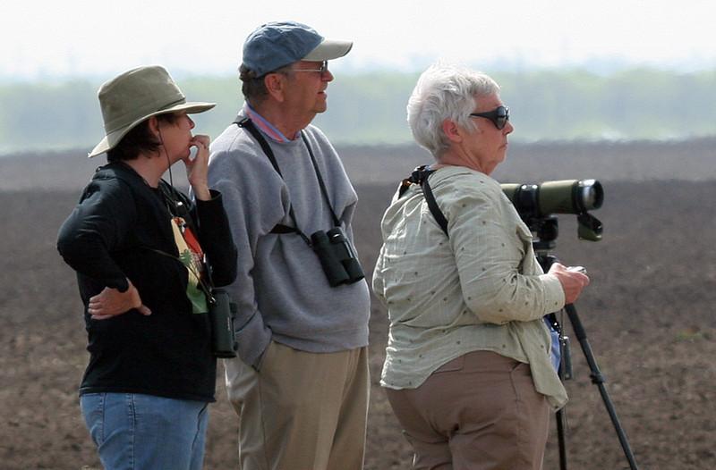 Reta, Dan and Diane waiting for the Burrowing Owl to flush -- no luck.