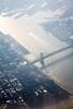 Over Manhattan Island and the Manhattan Bridge.