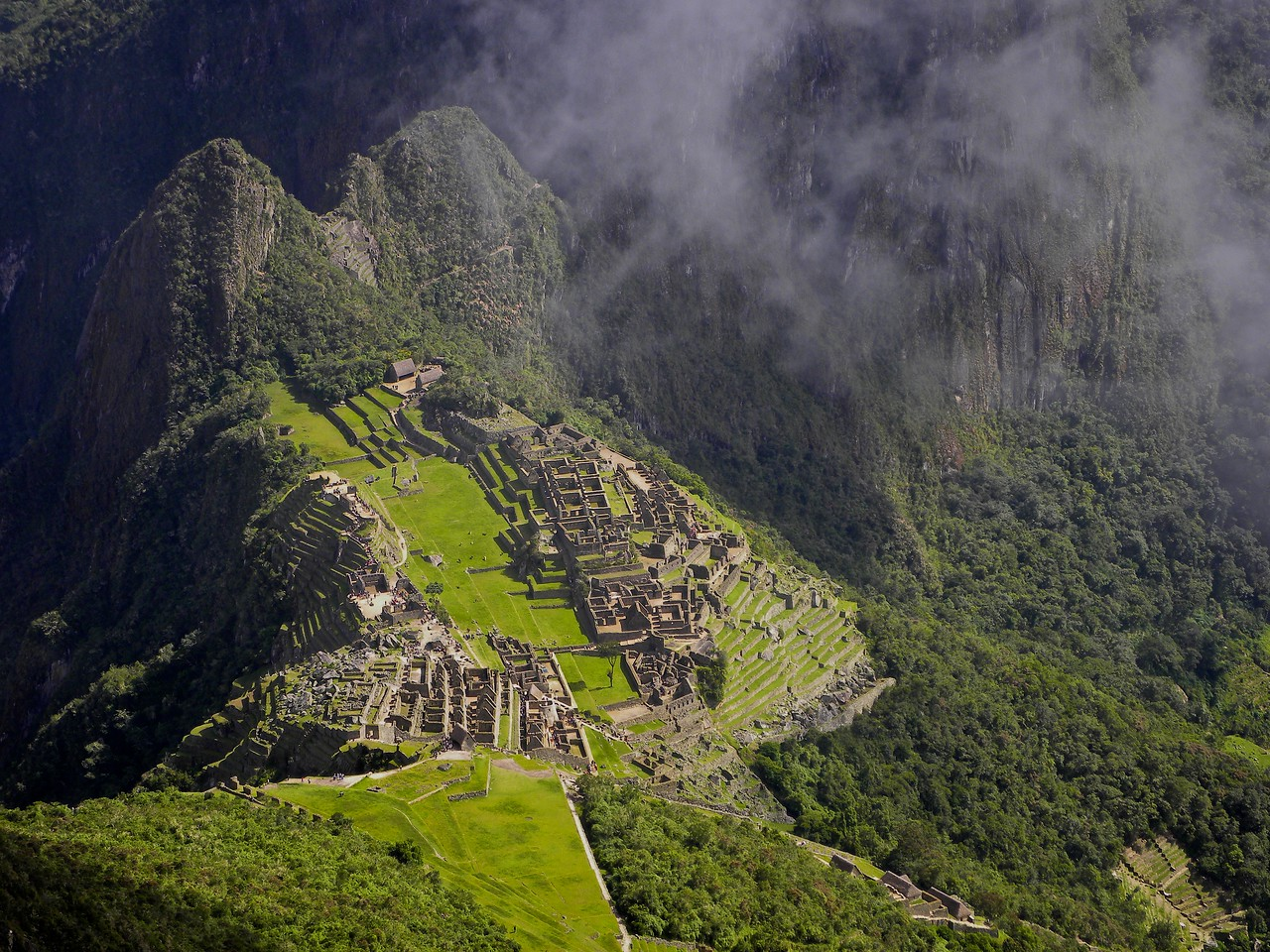The Machu Picchu ruin is located at an elevation of about 7000 feet. We climbed from there to the top of Machu Picchu the mountain and could look down on the archaeologic site and Huyana Picchu. The top was about 11000 feet.