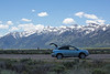Terry's little car in the shadow of the Teton Range; her Lexus stood up well in the face of high (12,000 ft. plus) altitudes and long days of driving. It did chug a little when fully loaded on steep grades, but plugged along okay.