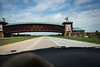 "A highway oddity; a ""gateway"" to the west...the sign on the right reads ""The Great Platte River Road Archway Monument""."