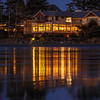 Long Beach Lodge Reflected On Wet Evening Sand