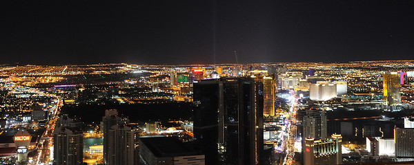 The Las Vegas strip as seen from the top of the Stratosphere. The beam of light is coming from the top of the Luxor hotel at the other end of the strip.