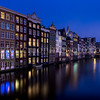 Houses along the Damrak channel at Amsterdam