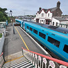 The Llanfairpwllgwyngyllgogerychwyrndrobwllllantysiliogogogoch, Wales, UK train station seen from a walkway over the tracks.
