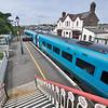 The Llanfairpwllgwyngyllgogerychwyrndrobwllllantysiliogogogoch, Wales, UK train station seen from a walkway over the tracks.