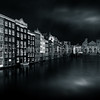 Houses along the Damrak channel at Amsterdam in B/W
