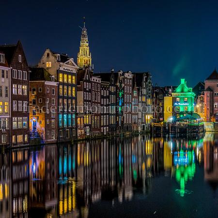 Damrak channel at Amsterdam by night