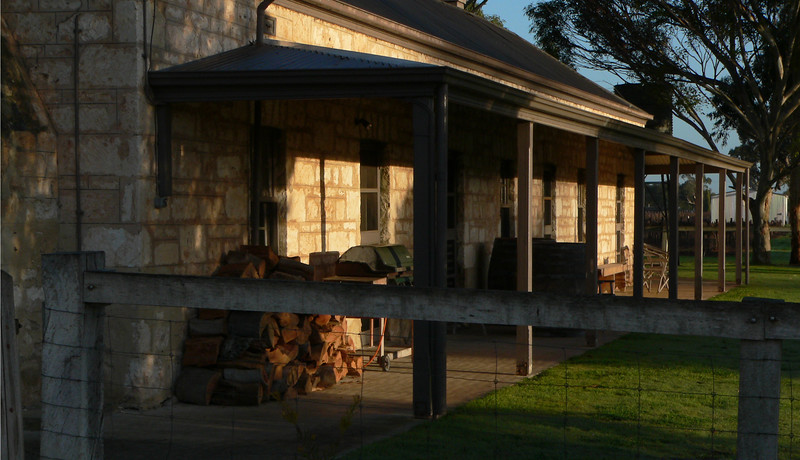 Historic sheep shearers ranch house in Australia in early morning light.