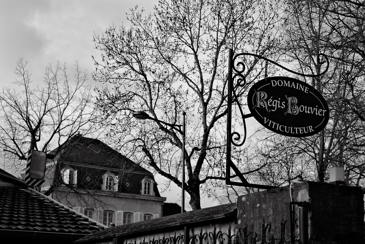 Black & white of Regis Bouvier sign in Marsannay, Burgundy.