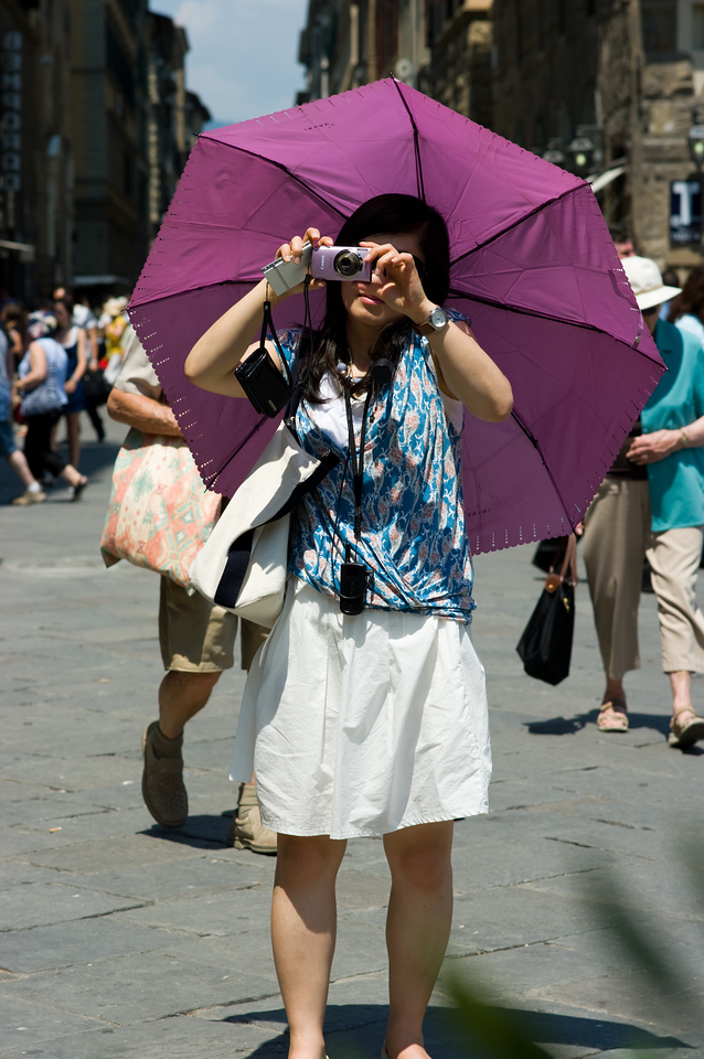 This is an example of combining two techniques: The photographic umbrella, and the Japanese tourist. Very effective.