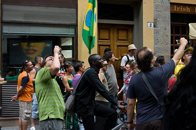 Lively street celebration on the streets of Florence of Brazilian soccer success in the World Cup.