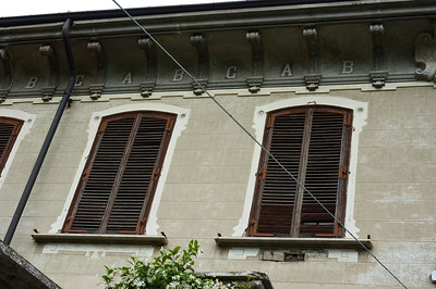 "Historic architecture of a school building in Serraluna d'Alba in the Piedmont wine region of Italy. Note the ""A, B, C's"" under the roof."