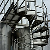 Stairway to stainless steel tanks used for making Gagliardo Favorita wine in the Piedmont region of Italy.