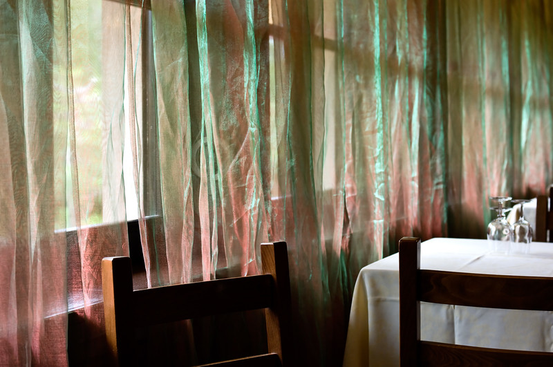 Shimmery curtains at restaurant.