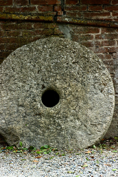 Ancient grinding stone at Sangervasio Winery and Castle in Tuscany.