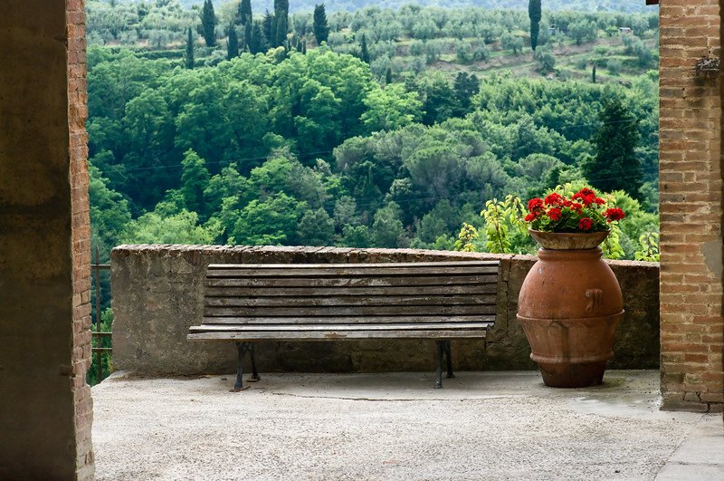 Stair landing view with flower pot at the Sangervasio Winery and castle in Tuscany.