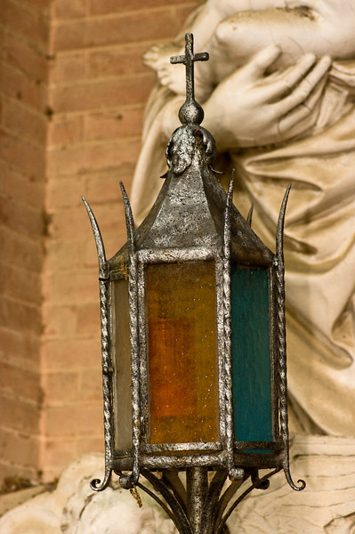 Close up of pewter lamp with colored glass at the Sangervasio Winery and castle in Tuscany.