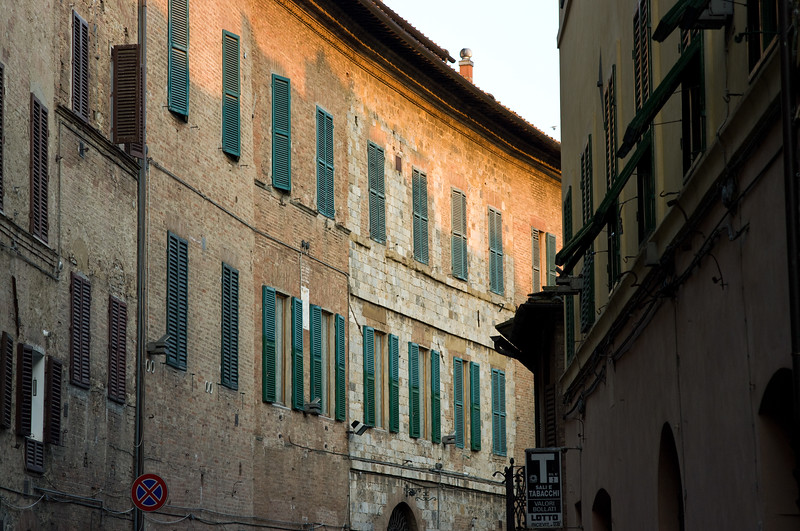 Curved street and sunset in Sienna, Italy.