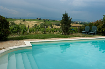 Swimming pool with expansive views at Fanetti's agriturismo (country side hotel) outside of Montepulciano in Tuscany, Italy.