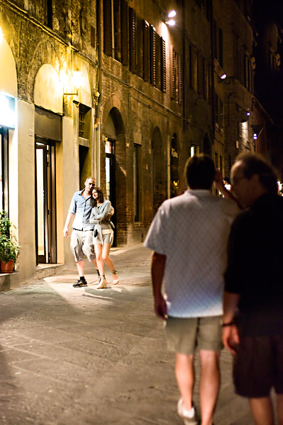 Street life at night in Sienna, Tuscany.