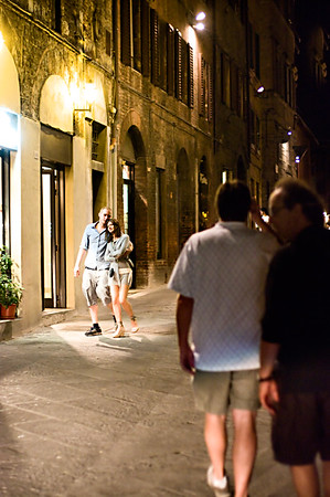 Street life at night in Sienna, Tuscany.