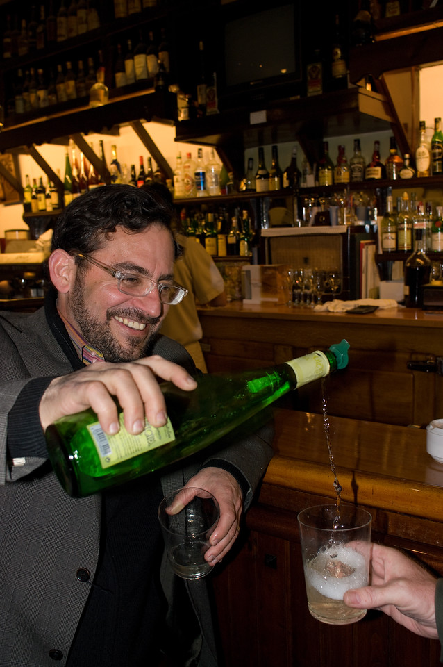 Andre Tamers, owner of De Masion Imports demonstrates how to pour Txakolina wine.<br /> (Pentax K20D with DA 21mm lens)
